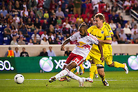Thierry Henry (14) of the New York Red Bulls shoots and scores during the first half against the Columbus Crew during a Major League Soccer (MLS) match at Red Bull Arena in Harrison, NJ, on September 15, 2012.