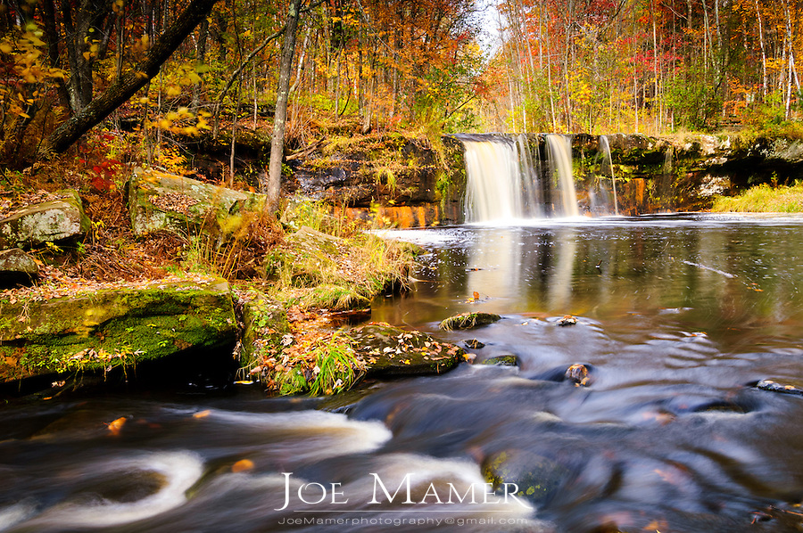 Autumn at Wolf Creek falls in Banning State Park in Minnesota.