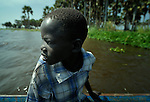 A boy in a boat on the Upper Nile River in Malakal, Southern Sudan.