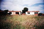 Abandonned prefabs in Newport, 2003. Thousands of post-war prefabs are still being lived in and cherished by their tenants or owners all over the UK.