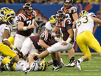 Logan Thomas of Virginia Tech gets tackled by Michigan defenders during Sugar Bowl game at Mercedes-Benz SuperDome in New Orleans, Louisiana on January 3rd, 2012.  Michigan defeated Virginia Tech, 23-20 in first overtime.