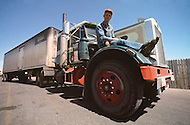 Kansas City, Missouri, September 9, 1978. W.A. Hitchcock, 48 years old, driving since 32 years. He is resting on the wing of his Peterbilt Truck. He is from Monroe, Colorado. His dream is to have a automatic transmision truck for his wife to drive with him. He wants his kids to become truck drivers.