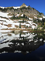 Naches Peak reflects in a small lake along the Naches Peak Loop Trail.