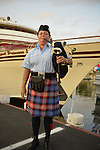 Freeport, New York, USA. 10th Sept. 2014. Member of Wantagh American Legion Pipe Band plays during a dockside remembrance ceremony in honor of victims of the terrorist attacks of September 11 2001, at the boat Miss Freeport V, on Freeport's Nautical Mile. Further ceremonies were held on board the vessel, which sailed from the Woodcleft Canal on the South Shore of Long Island, on the eve of the 13th Anniversary of the 9/11 attacks.