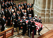 The casket containing the remains of former United States President Gerald R. Ford is carried by a military honor guard into the Washington National Cathedral, in Washington, D.C. on Tuesday, January 2, 2007. In the front row are: President George W. Bush,first lady Laura Bush,Vice President Dick Cheney, Lynne Cheney,former President Jimmy Carter, former first lady Roslyn Carter, and former first lady Nancy Reagan.  In the second row are former President George H.W. Bush, former first lady Barbara Bush, Doro Bush Koch, former President Bill Clinton, former first lady Senator Hillary Rodham Clinton (Democrat of New York), Chelsea Clinton, Secretary of State Condoleezza Rice, Secretary of the Treasury Henry M. Paulson, Jr., and Secretary of Defense William Gates.  Jack Ford looks on from far left..Credit: Ron Sachs / CNP..[NOTE: No New York Metro or other Newspapers within a 75 mile radius of New York City].