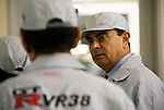 Carlos Ghosn, president and CEO of Nissan Motor Co., is given a tour of the automaker's engine assembly plant in Yokohama, Japan on Monday 26 Oct.  2009. .Photographer: Robert Gilhooly/Bloomberg News