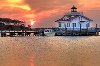 The sun  burning through the low-lying clouds at Roanoke Marshes Lighthouse in  Manteo North Carolina.