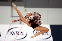 September 21, 2007; Patras, Greece;  Eleni Andriola of Greece stag leaps with rope during the All-Around final at 2007 World Championships Patras.  Eleni placed 12th in the AA to qualify Greece for one position in the individual All-Around competition at Beijing 2008 Olympics Games and the possibility of making her 2nd Olympic Games.  Photo by Tom Theobald. .