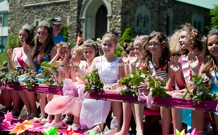 WINSTED, CT--061315JS03-   Future Laurel Queens wave as they ride the float down Main Street during the 2015 Laurel Festival Parade and ceremonies in Winsted on Saturday.<br /> Jim Shannon Republican-American