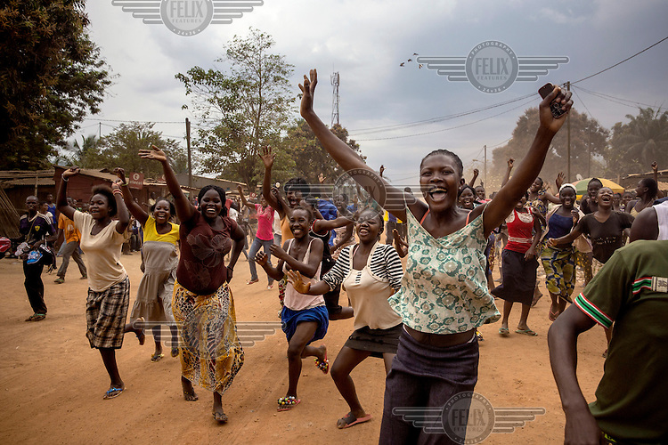 Some of Bangui's Christian population celebrating the last Seleka fighters to leave camp Kasai. A few minutes later they began to loot and destroy the Muslims houses around the camp.  In 2013 a rebellion by a predominantly Muslim rebel group Seleka, led by Michel Djotodia, toppled the government of President Francios Bozize. Djotodia declared that Seleka would be disbanded but as law and order collapsed the ex-Seleka fighters roamed the country committing atrocities against the civilian population. In response a vigillante group, calling themselves Anti-Balaka (Anti-Machete), sought to defend their lives and property but they then began to take reprisals against the Muslim population and the conflict became increasingly sectarian. French and Chadian peacekeeping forces have struggled to contain the situation and the smaller Muslim population began to flee the country.