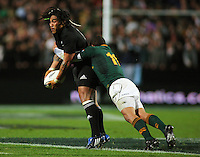 All Blacks centre Ma'a Nonu looks to pass in the tackle of Bryan Habana during the Investec Tri-Nations rugby match between the NZ All Blacks and South African Springboks at Waikato Stadium, Hamilton, New Zealand on Saturday 12 September 2009. Photo: Dave Lintott / lintottphoto.co.nz