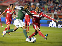 Chicago defender Cory Gibbs (5) attempts to block a shot by Portland defender Jeremy Hall (17).  The Portland Timbers defeated the Chicago Fire 1-0 at Toyota Park in Bridgeview, IL on July 16, 2011.