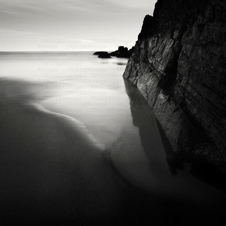 Still water on a sandy beach