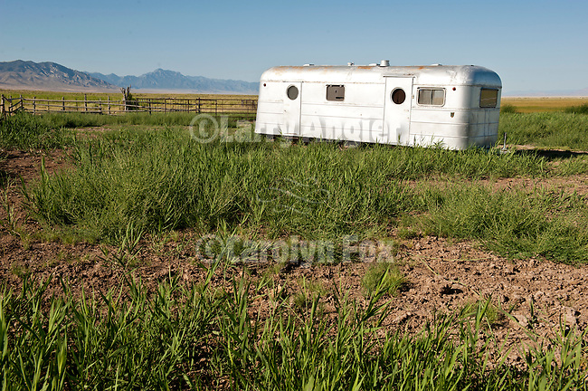 Abandoned house trailer and vehicles in the Blue Eagle Ranch boneyard, Nev.