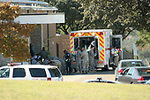 Fort Hood, TX - November 5, 2009 -- First responders prepare the wounded for transport in waiting ambulances outside Fort Hood's Soldier Readiness Processing Center, Thursday, November 5, 2009. .Mandatory Credit: Jeramie Sivley - U.S. Army via CNP