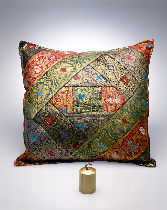 PILLOW &amp; SMALL WEIGHT HAVE SAME MASS<br /> The weight has a higher density because its volume is smaller.