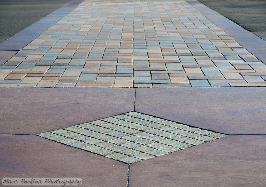 "The colored-concrete (and stone?) crosswalk at the Grand and Diamond Bar intersection. This was part of the 2015 rebuild of the Grand Avenue and Diamond Bar Boulevard intersection for Diamond Bar's 2015 ""Grand Avenue Beautification"" project, landscape architecture for the project was by David Volz Design."