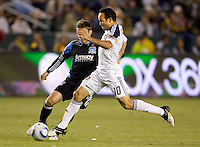 San Jose Earthquakes midfielder Bobby Convey (11) and LA Galaxy midfielder Landon Donovan (10) battle. The LA Galaxy and the San Jose Earthquakes played to a 2-2 draw at Home Depot Center stadium in Carson, California on Thursday July 22, 2010.