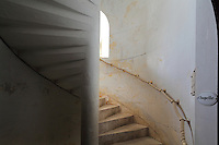 Staircase leading from the royal chapel to the Salle des Girondins or Salle des Bordelais, at the Phare de Cordouan or Cordouan Lighthouse, built 1584-1611 in Renaissance style by Louis de Foix, 1530-1604, French architect, located 7km at sea, near the mouth of the Gironde estuary, Aquitaine, France. This is the oldest lighthouse in France. There are 4 storeys, with keeper apartments and an entrance hall, King's apartments, chapel, secondary lantern and the lantern at the top at 68m. Parabolic lamps and lenses were added in the 18th and 19th centuries. The lighthouse is listed as a historic monument. Picture by Manuel Cohen