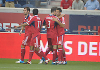 Chicago midfielder Marco Pappa (16) gets a hug from Dan Gargan after scoring an early goal to put the Fire ahead 1-0.  The Chicago Fire defeated the Columbus Crew 2-1 at Toyota Park in Bridgeview, IL on June 23, 2012.