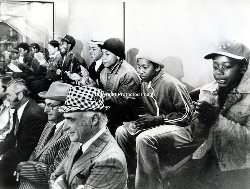 Oakland Athletics owner Charlie Finley sitting in his private box with a group of Oakland kids including Charles Burell (AK M.C.Hammer) sitting on far right above Finley. (photo by Ron Riesterer) 1971?