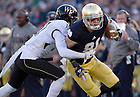 Nov. 17, 2012; Wide receiver John Goodman gains 9 yards before being forced out of bounds by Wake Forest free safety A.J. Marshall during the first quarter. Photo by Barbara Johnston/University of Notre Dame
