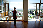 Sales manager Samantha Reveley leads a tour of a penthouse in The Montage, an old casino renovated into luxury condos in downtown Reno, Nevada, July 6, 2012.