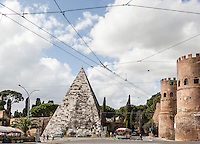 Pyramid of Caius Cestius and the Porta San Paolo in Rome, Italy.<br />