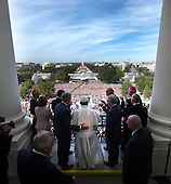 His Holiness Pope Francis is welcomed to the Speakers Balcony at the US Capitol by members of congress, Thursday, Sept. 24, 2015. <br /> Credit: Doug Mills / Pool via CNP