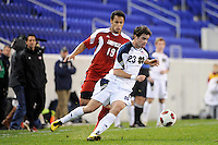 Michael Rose (23) of the Notre Dame Fighting Irish is chased by Kenney Walker (19) of the Louisville Cardinals. The Louisville Cardinals defeated the Notre Dame Fighting Irish 1-0 during the semi-finals of the Big East Men's Soccer Championship at Red Bull Arena in Harrison, NJ, on November 12, 2010.