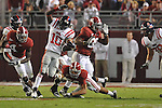 Ole Miss wide receiver Jesse Grandy (10) runs past Alabama defensive back DeMarcus Milliner (28) and Alabama linebacker Dont'a Hightower (30) at Bryant-Denny Stadium in Tuscaloosa, Ala.  on Saturday, October 16, 2010. Alabama won 23-10.