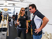 Aug 19, 2016; Brainerd, MN, USA; NHRA top fuel driver Leah Pritchett (left) talks with Papa Johns pizza founder John Schnatter during qualifying for the Lucas Oil Nationals at Brainerd International Raceway. Mandatory Credit: Mark J. Rebilas-USA TODAY Sports