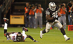 Oakland Raiders running back Amos Zereoue (28) gets away from Tampa Bay Buccaneers linebacker Derrick Brooks (55) on Sunday, September 26, 2004, in Oakland, California. The Raiders defeated the Buccaneers 30-20.
