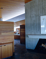 Architect Helena Arahuete has created her own signature detail in the faux bois concrete design on some  interior walls