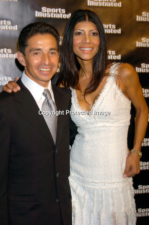 Jose and Rita Santos..at the 2004 Sports Illustrated Swimsuit Issue Press Event at ..Deep in NYC on Tuesday 10, 2004.                              Photo by Robin Platzer, Twin Images