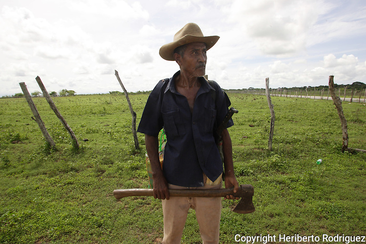 An Afro-Mexican holds an axe as he makes his way to his ranch in San Nicolas village in the coast of Guerrero state, July 6, 2005. Afro- Mexicans are considered one of the three ethnic roots that comprise Mexico. Photo by Heriberto Rodriguez