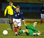 Scott Arfield challenges Cory Evans and Robbie Weir of Northern Ireland