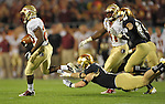 Safety Dan McCarthy (15) makes a diving attempt at FSU kick returner Lamarcus Joyner (20) in the third quarter.