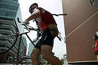 3 July 2005 - Jersey City, NJ, USA - A rider leaves a checkpoint with an envelope he must delilver at another checkpoint in the final race of the 13th annual cycle messenger world championships, Jersey City, USA, July 2nd 2005. More than 700 riders from all over the world took part in the 4-day competition which carries event based on the daily work of a city bike messenger.