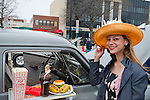 March 31, 2013 - Garden City, New York, U.S. - JENNY MOSCO, of Plainview, wears a straw and feather Easter Bonnet as she strikes a pose in front of a 1951 Studebaker with snack tray attached outside front passenger window, at the 58th Annual Easter Sunday Vintage Car Parade and Show sponsored by the Garden City Chamber of Commerce. Hundreds of authentic old motorcars, 1898-1988, including antiques, classic, and special interest participated in the parade.