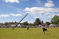 Neil Elliott competes in the tossing the caber competition at the Helensburgh and Lomond Highland Games in Argyll. Neil competes in over 40 heavyweight events across the world throughout the summer.