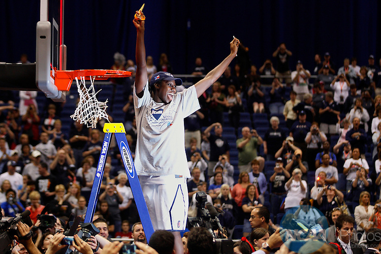 06 APR 2010:  Tina Charles (31) of the University of Connecticut cuts down the net after the Huskies victory over Stanford University during the Division I Women's Basketball Championship held at the Alamodome in San Antonio, TX.  Connecticut defeated Stanford 53-47 for the national title.  Jamie Schwaberow/NCAA Photos