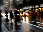 A city street scene in winter with blurred lighting