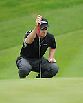 Leader Scott Strange eyes up his putt on the 3rd. Celtic Manor Wales Open 2008 © IJC Photography 2008, iancook@ijcphotography.co.uk..