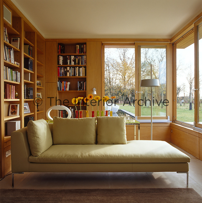 A Charles sofa by Antonio Citterio is a good place to unwind in this tranquil contemporary library