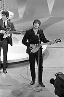 Beatles' John Lennon and George Harrison perform on Ed Sullivan Show, Feb 1964, New York City. Photographer John G. Zimmerman. C1-10.