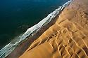 Namibia, Namib Desert, Skeleton Coast, aerial view of sand dunes and Atlantic Ocean