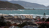 Windsurfers & kiteboarders making the most of the wind & surf at Lyall Bay, Wellington, New Zealand