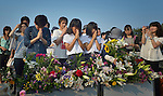 People praying on August 6, 2015, at a memorial in Hiroshima, Japan, that commemorates the victims of the atomic bombing of the city by the United States in 1945.