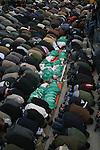 Palestinians pray beside the bodies of senior Hamas leader Nizar Rayyan and his family during their funeral in Jabalya in the northern Gaza Strip  APAIMAGES PHOTO / Ashraf Amra